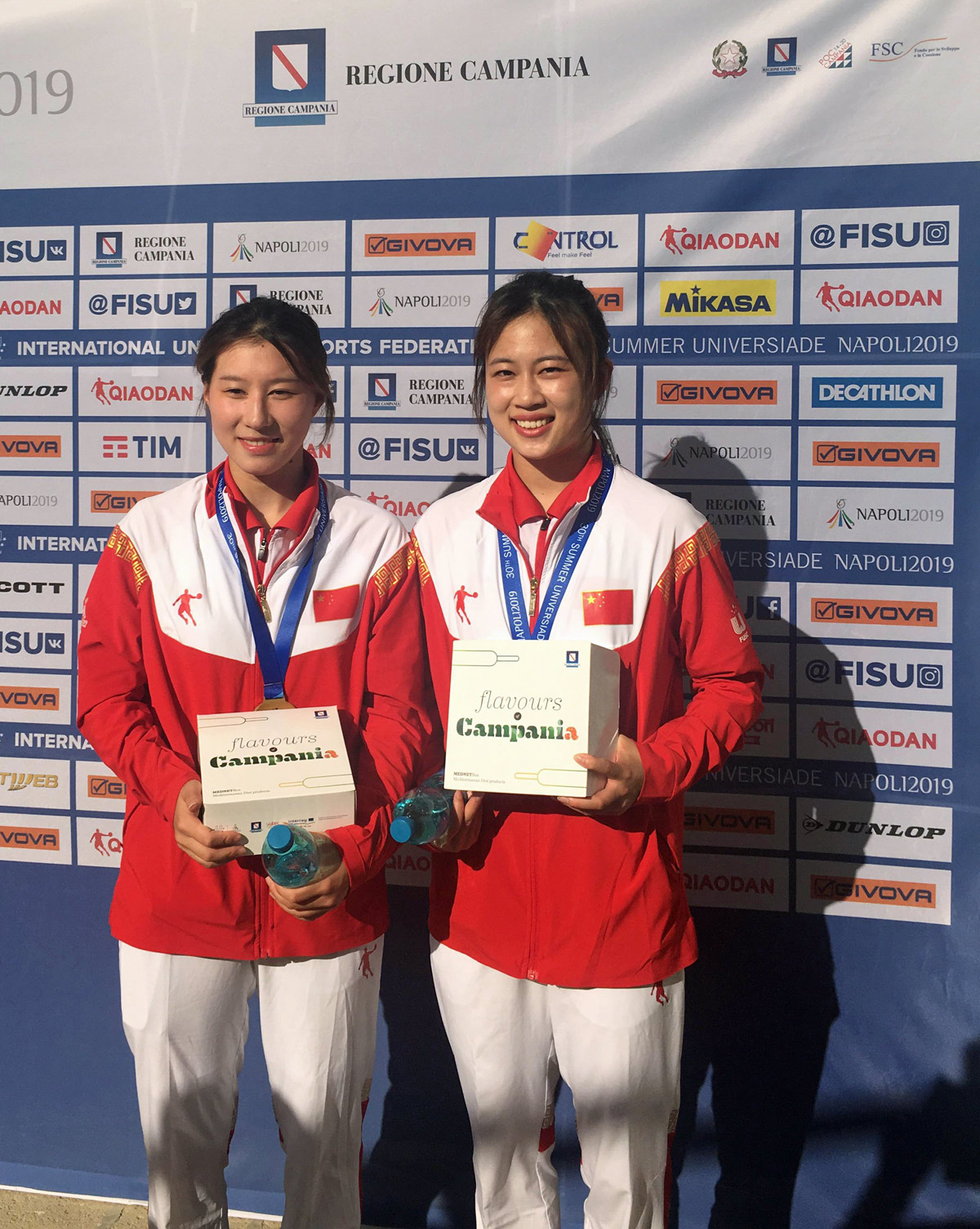 The golden girls from the Women's 10m Synchronised Platform, Jingjing Jiao and Jiao Wu, during their mixed zone interviews after the podium ceremony